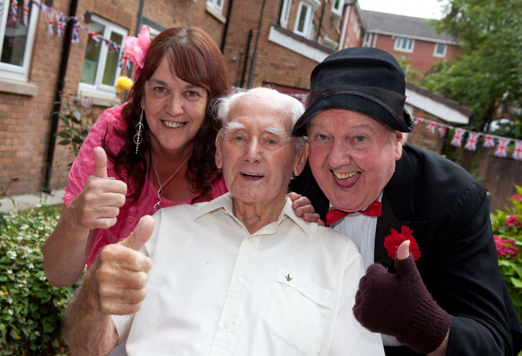 Scheme manager Stella Watson and resident William Royle with Jimmy Cricket. Photo by Ian Howarth.