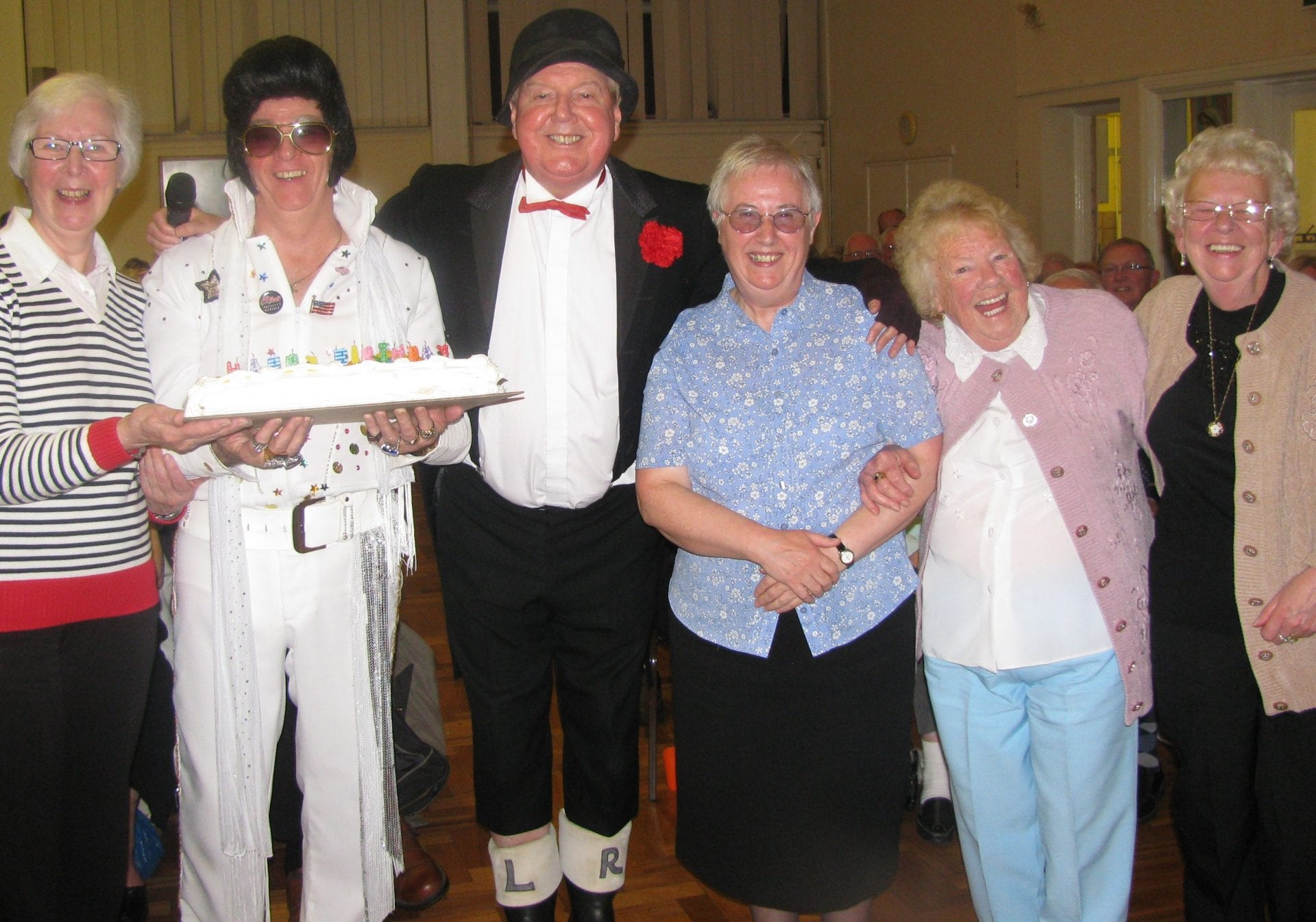Jimmy Cricket, with his birthday cake, Jim Nicholas and the local organising committee for the event