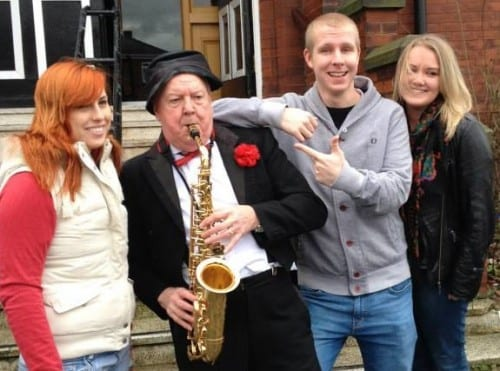 Jimmy Cricket plays the saxophone during his Ormskirk walkabout