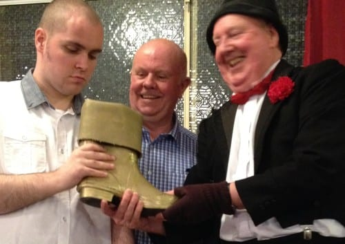 Jimmy Cricket awards the Golden Wellington to Martin Finn, whose dad John watches on