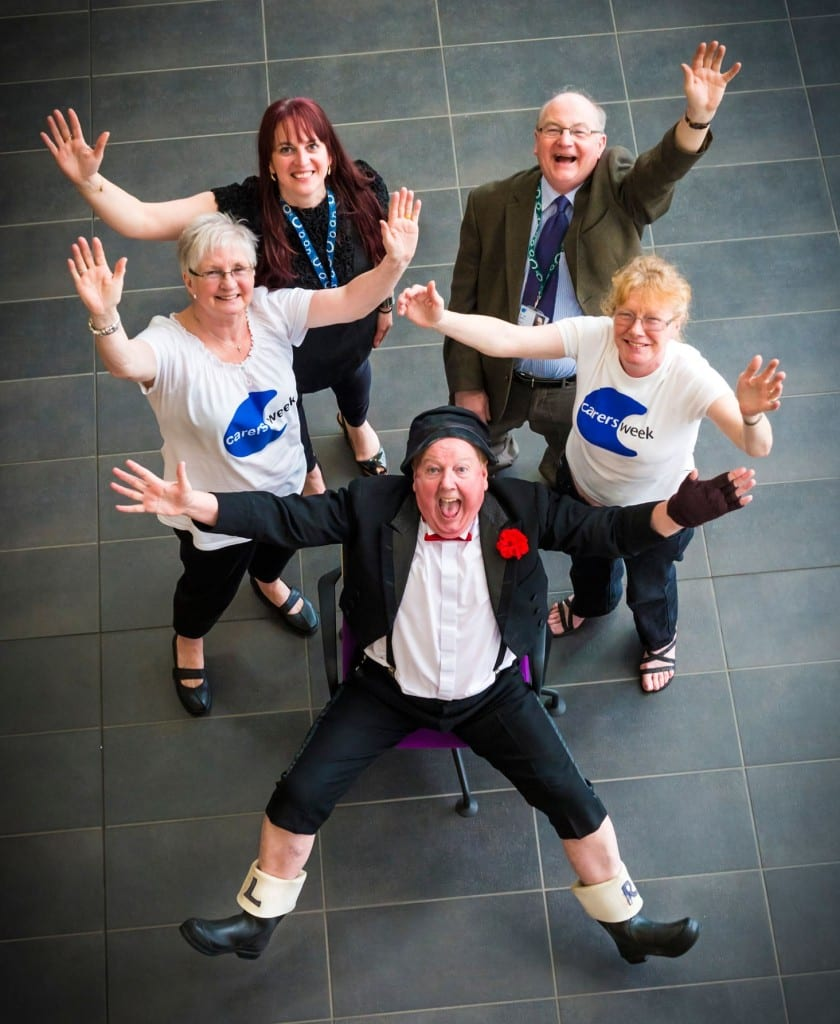 Jimmy Cricket with two local carers, the acting chief executive of Rochdale council – Linda Fisher - and councillor Billy Shearin