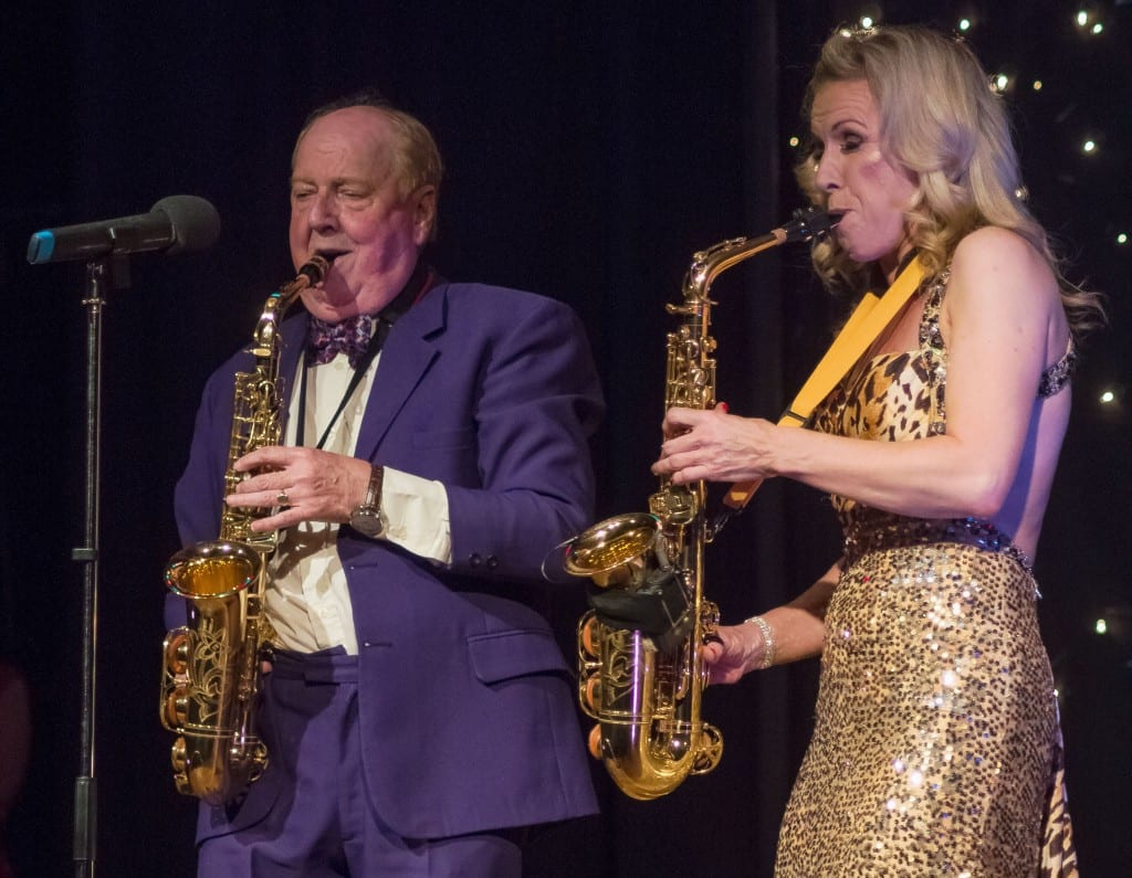 Jimmy Cricket plays the saxophone with instrumentalist Rachel King