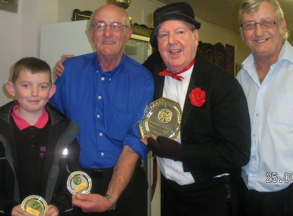 Jimmy Cricket awards the top junior prize to Kieran McGarry, alongside club president Pete Metcalf and club secretary Steve Morris