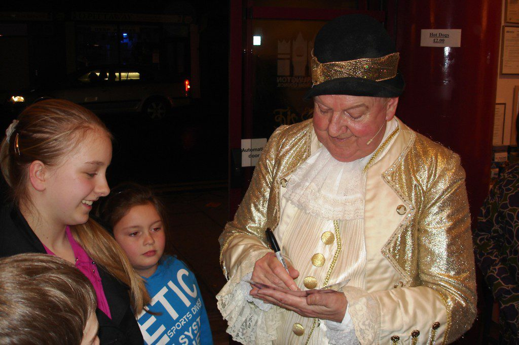 Jimmy gives his autograph in the theatre foyer after one of the panto performances