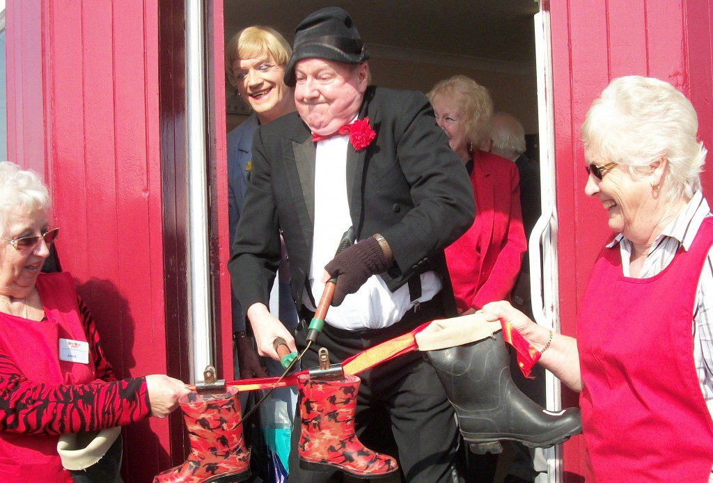 Jimmy cuts the ribbons to open the new theatre charity shop