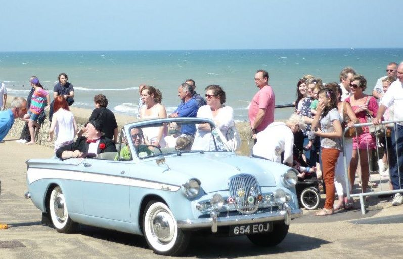 Jimmy Cricket has a ride in a blue cadillac in Cromer