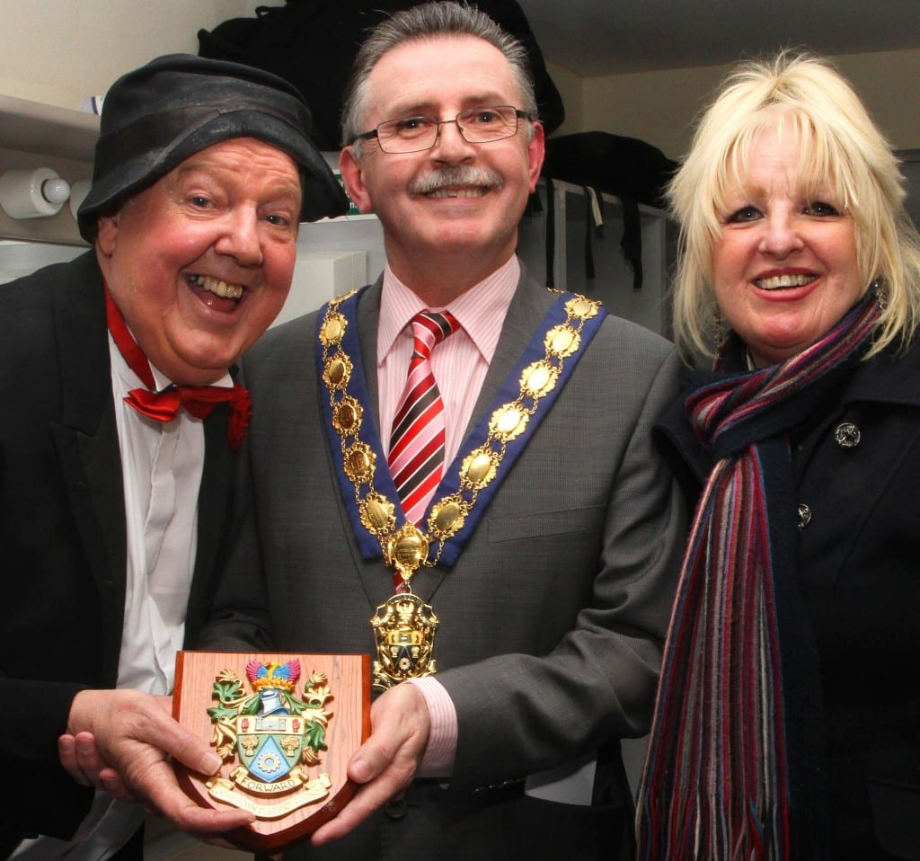 Cllr Tony Quinn awards the plaque to Jimmy Cricket who is accompanied by his wife, May