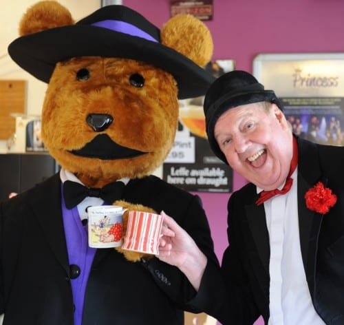 Jimmy Cricket has a cuppa with the Princess Theatre mascot