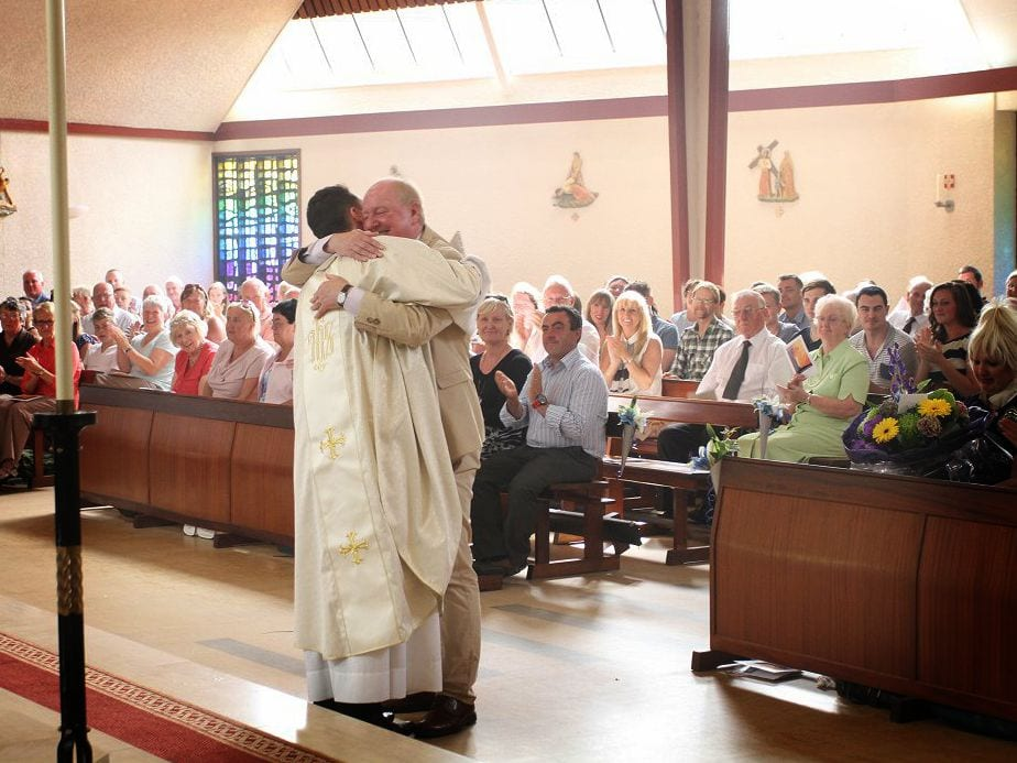 Fr Frankie hugs his dad Jimmy Cricket after dedicating his book, Does God LOL?, to him