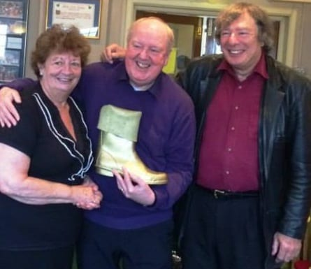 Jimmy Cricket presents the April Golden Wellie award to Norman Jacobs and Joan Beatton