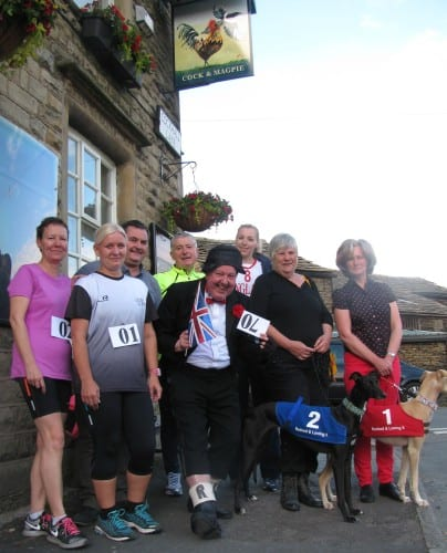 Jimmy Cricket and runners outside the Cock & Magpie pub in Whitworth
