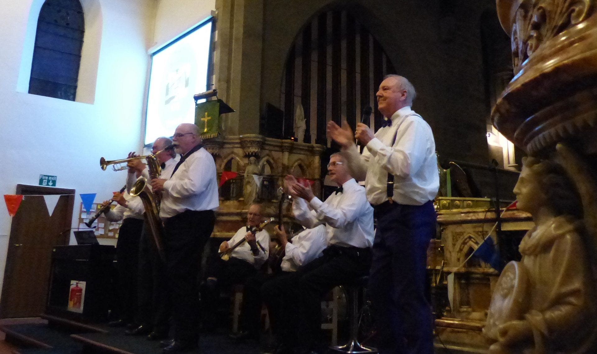 Jimmy Cricket sings with the choir at the birthday celebration for All Saints Church