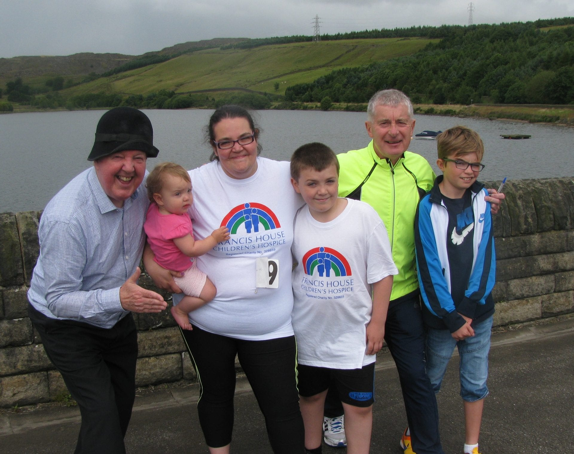 Jimmy Cricket with race organiser Andy O'Sullivan, runner Jo Davies, her two children - Lucas Davies and Lillie Mai Davies - and Daniel Barker at the scene of the fun run near Cowm Reservoir