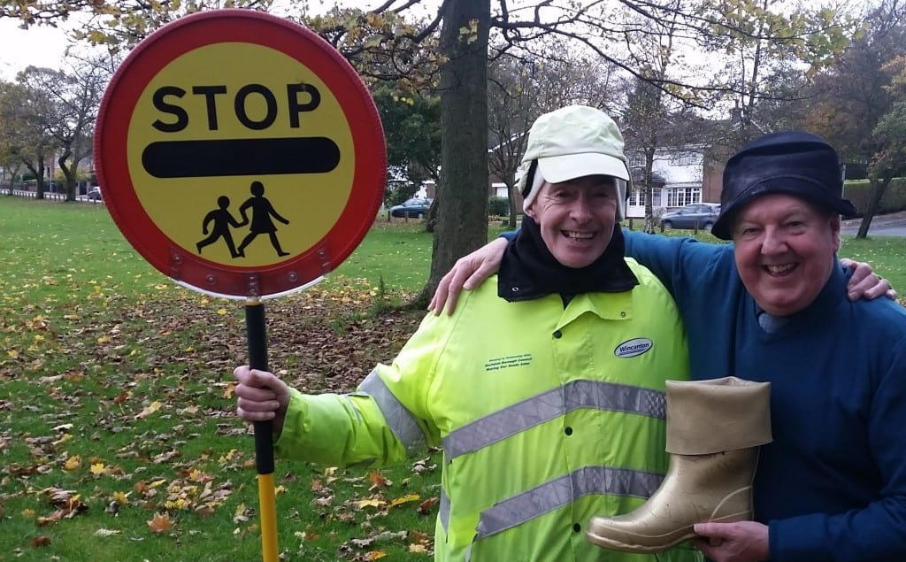 Jimmy Cricket presents the Golden Wellington award to school crossing patrol man Don Frain