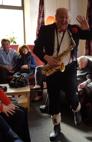 Jimmy Cricket playing the saxophone