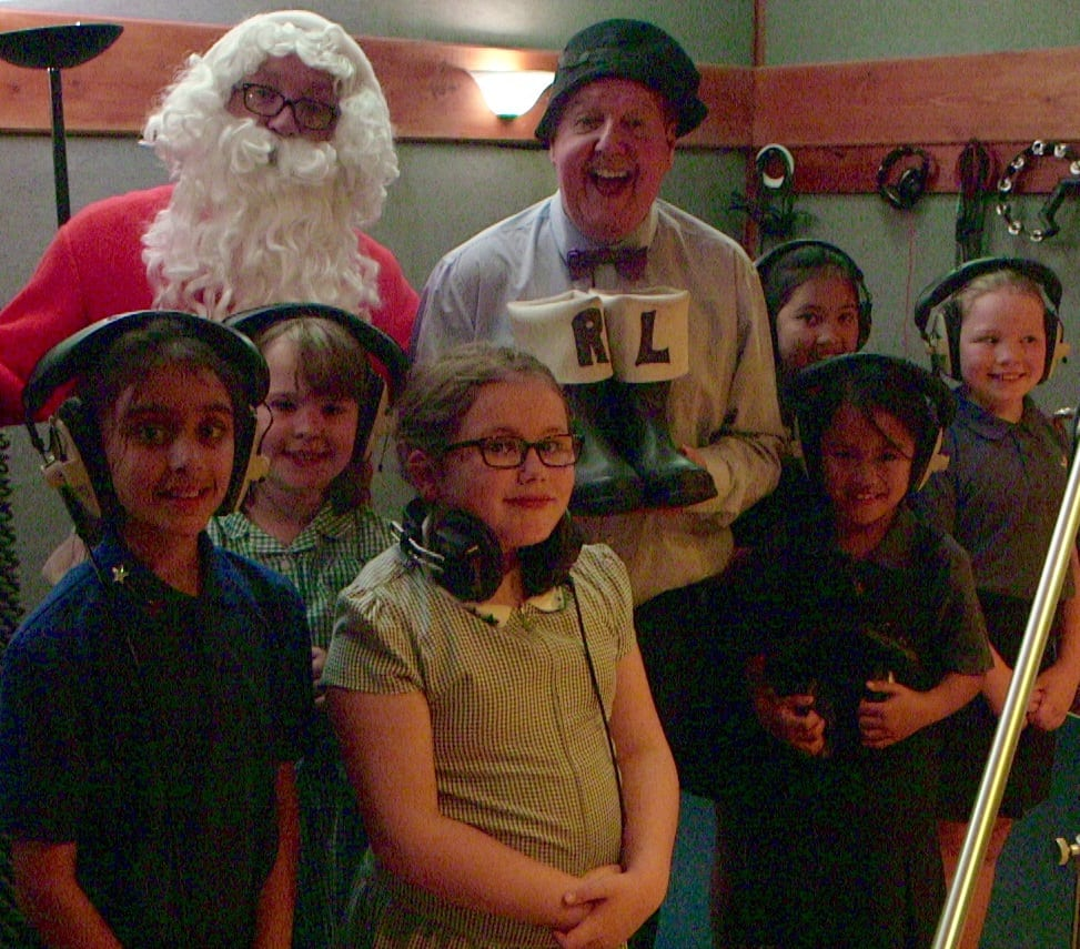 Jimmy Cricket with Father Christmas and the choir from St Patrick's RC Primary School in Rochdale