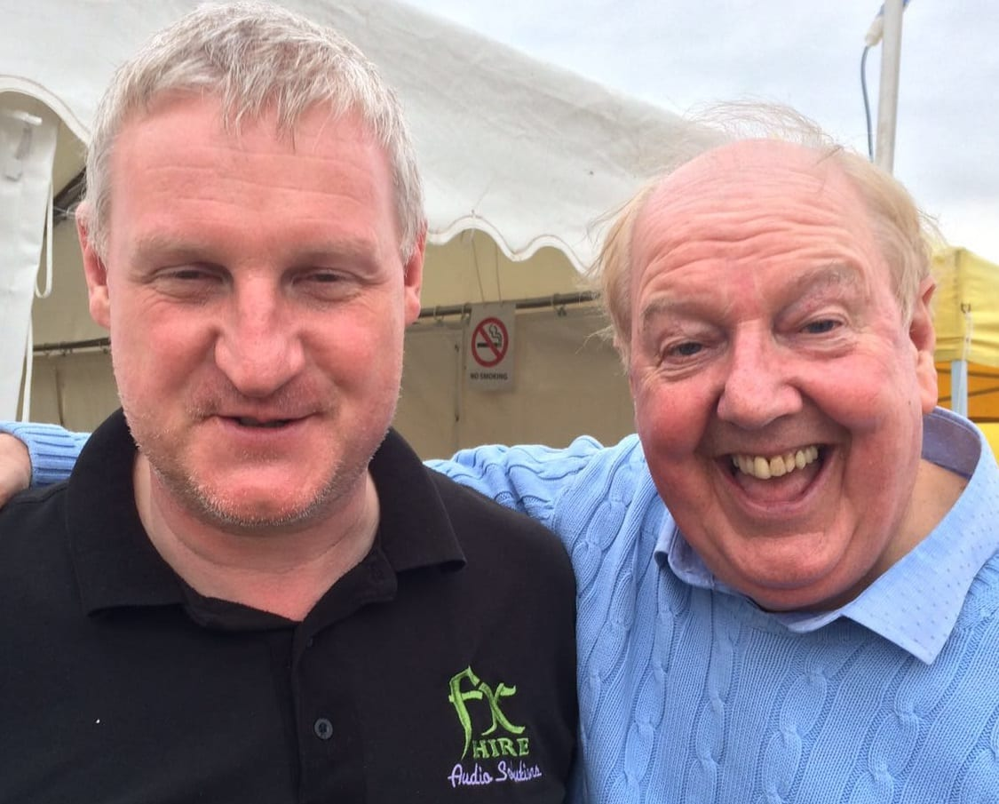 Jimmy Cricket with the festival's Variety Stage sound engineer, Phil